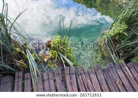 wooden walkway around the lake - stock photo