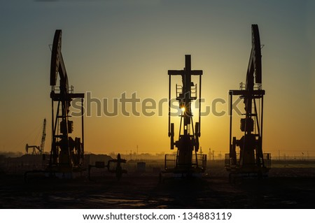 Work of oil pump jack on a oil field. Oil and gas industry.