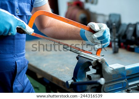 worker on work bench in the factory - stock photo