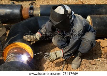Worker   welder  repair   pipeline - stock photo