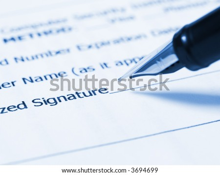 Writing signature (Person writing her signature)