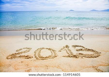 2013 written in sand on beach - stock photo