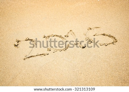 2016 written in the sand of a beach - stock photo