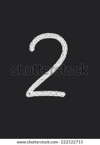 2 written on a black blackboard - stock photo