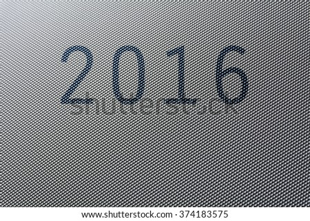 2016 written on a piece of plastic texture
