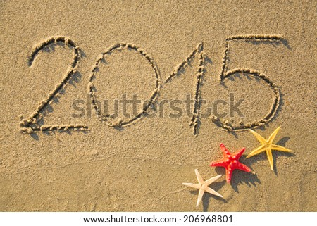 2015 written on sandy beach  - stock photo