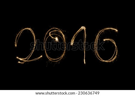 2016 written with a sparkler isolated on black background - stock photo