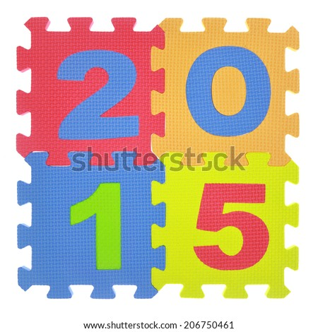 2015 written with jigsaw puzzle pieces isolated - stock photo
