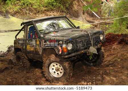 4x4 action through a huge mud hole.
