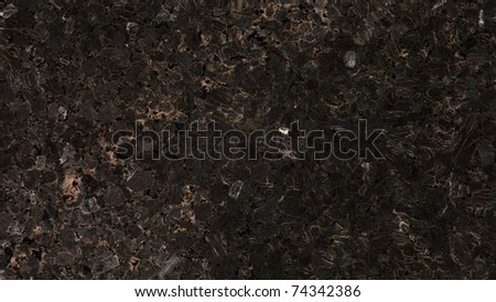 1x4ft Sample of Brazilian Granite Olinda Coffee, a dark, large-grained granite. It has chips of mica that may reveal hues of copper, silver and blue - stock photo