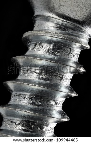 4.5X magnification of a screw close-up with full depth of field, showing the details of its surface. - stock photo