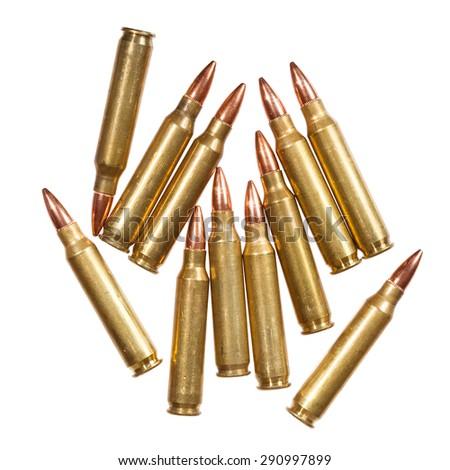 5.56x45mm NATO intermediate cartridges isolated on white. - stock photo