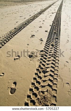 4x4 tiretracks in the sand - stock photo