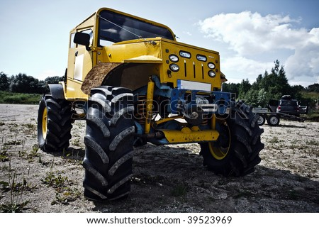 4x4 truck befeore competition front view low angle desaturated colours - stock photo