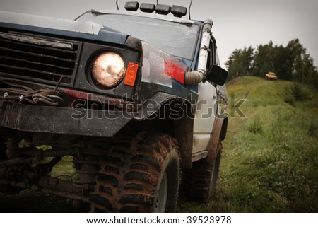 4x4 truck during competition front view low angle desaturated colours - stock photo