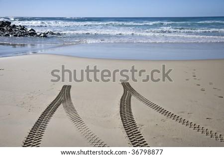 4x4 tyre tracks on beach, Fraser Island, Queensland, Australia - stock photo