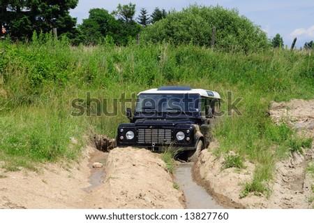 4x4 vehicle aground - stock photo