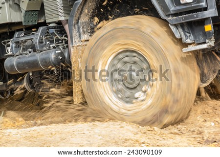 4x4 vehicle driving offroad in  muddy terrain  in the wilderness - stock photo