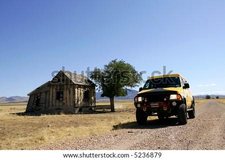 4x4 yellow van in Utah ranch land - stock photo
