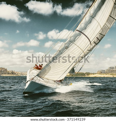 Yachting. Sailing. Sailing yachts regatta. Toned image and blur. Retro style postcard.  - stock photo