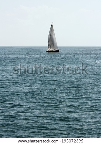 Yachts with white sails on the sea