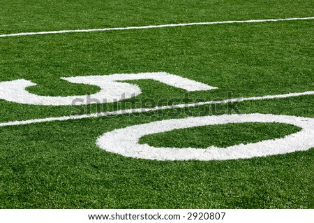50 yard line at a Football Field, Artificial Turf - stock photo