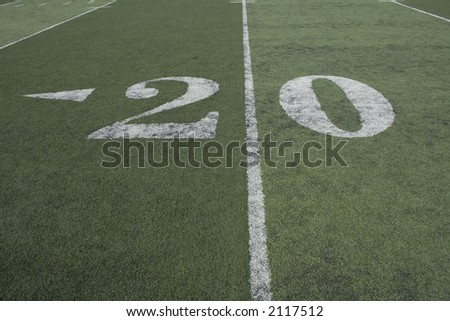 20 yard line of a football field where all the action happens. - stock photo