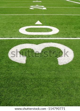 30, 20, 10 yard line on a football field - stock photo