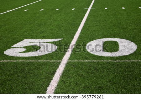 50 yard line on a football field - stock photo