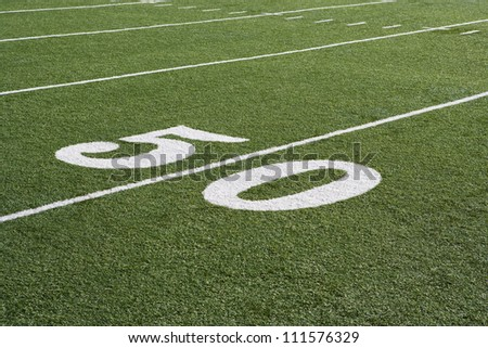 50 yard line on American football field - stock photo