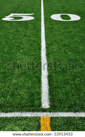 50 Yard Line on American Football Field and Sideline - stock photo