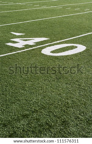 40 yard line on American football field with artificial turf