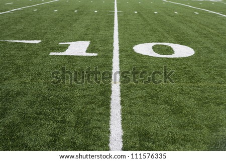 10 yard line on American football field with artificial turf - stock photo