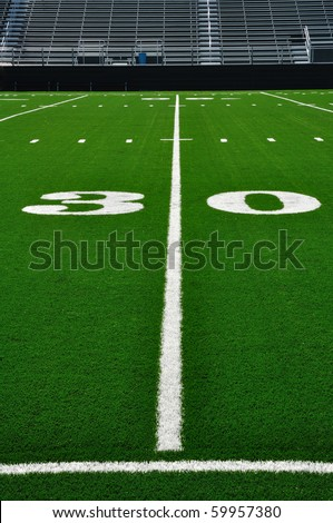 30 Yard Line on American Football Field with Bleachers - stock photo