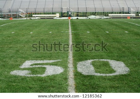 50 yard line with bleachers in the background - stock photo