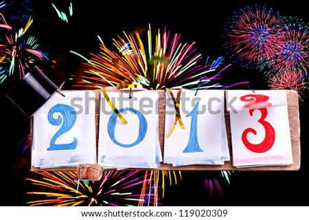 2013 year desk calendar with happy new year decoration, switching from year 2012 to year 2013, Happy New Year celebration background - stock photo