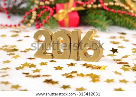 2016 year golden figures and spruce branch and Christmas decorations - stock photo