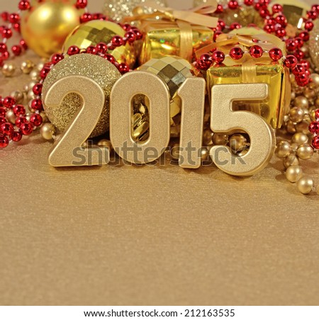 2015 year golden figures on the background of christmas decorations - stock photo