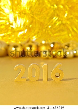 2016 year golden figures on the background of golden Christmas decorations