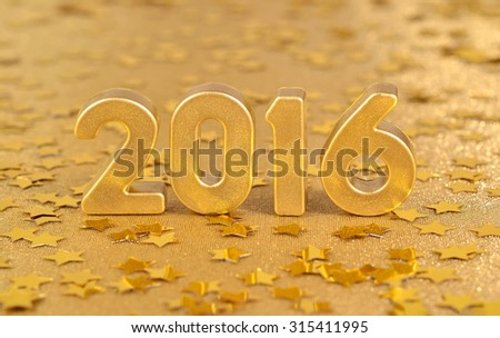 2016 year golden figures on the background of golden stars - stock photo