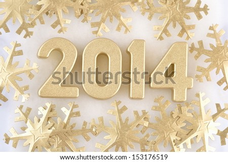 2014 year golden figures on the background of snowflakes