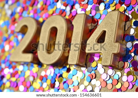 2014 year golden figures on the background of varicolored confetti