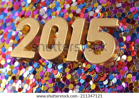 2015 year golden figures on the background of varicolored confetti