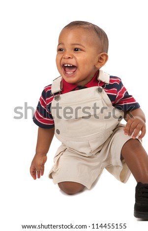 1-year old African American baby boy Sit on Floor Laughing portrait on isolated white - stock photo