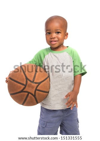 2 year old African American baby boy standing holding basket ball on isolated background - stock photo