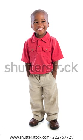 2 year old african american baby boy  standing wearing t-shirt and dress pants  isolated on white background