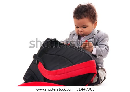 1 year old baby boy and bag isolated white background