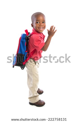 3 year old baby boy standing wear casual outfit carrying backpack fun gesture isolated on white background
