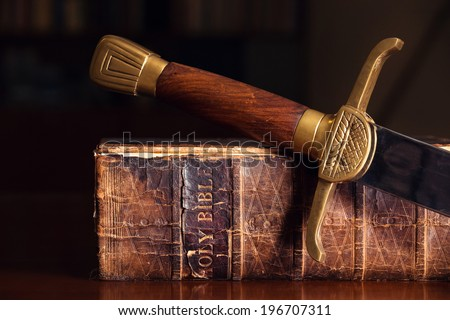 150 Year Old Bible With Sword - stock photo