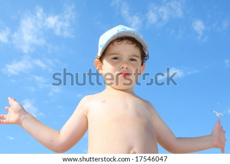 3 year old boy against the sky